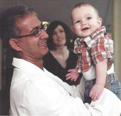 Dr. Derek Rodrigues with Sandra Lemon and her baby.